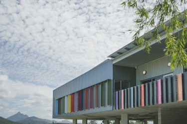 Colourful exterior of Tweed Regional Gallery with Mt Warning in the background