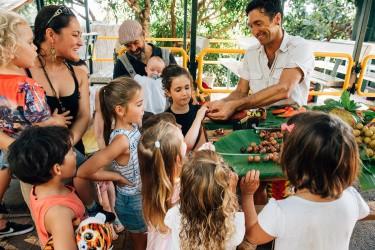 Kids enjoying fruit tasting at Tropical Fruit World, Duranbah, NSW