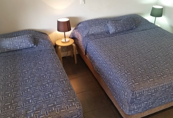 Two beds with blue bed covers